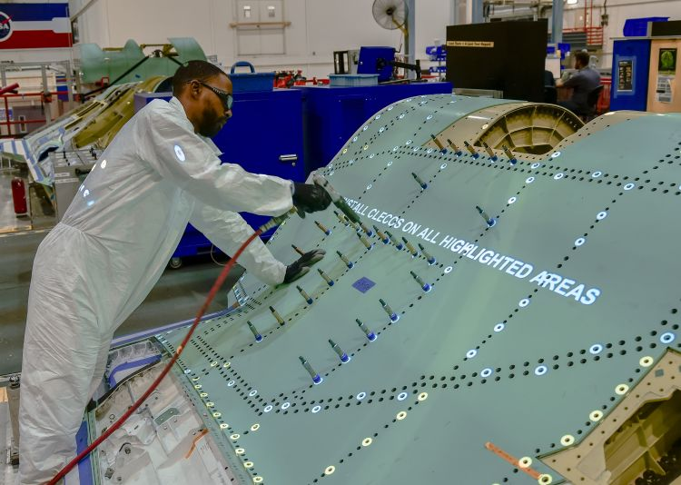Northrop Grumman mechanic uses FILLS light projected work instructions to speed the assembly of an F-35 center fuselage.jpg